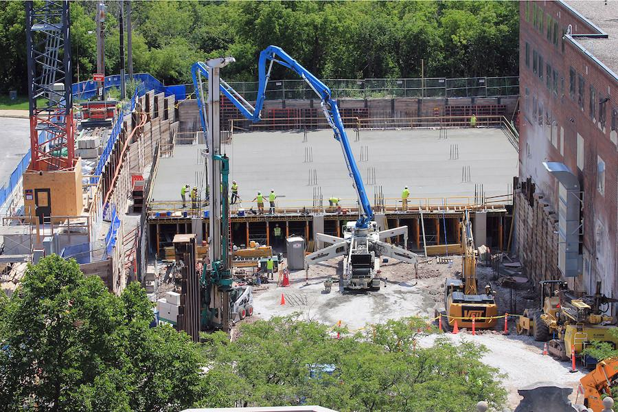 Excavators, off-road trucks and concrete-pump equipment have effortlessly joined the cranes and the crew in working on the foundations of the 22-story tower.
