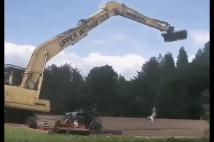 While it might look like great fun, attaching a rope to an excavator and then swinging into a pond of unknown depth is not exactly the safest of ideas.