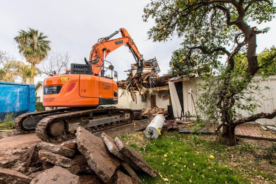 Residential construction in Phoenix, Ariz., is going so strong that developers are paying contractors to demolish existing homes and make space for newer, bigger and more expensive homes.