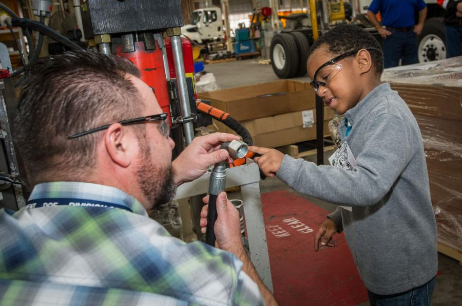 This photograph of a California Department of Transportation (Caltrans) worker giving a Make-A-Wish child a tour of a maintenance facility won the Grand Prize