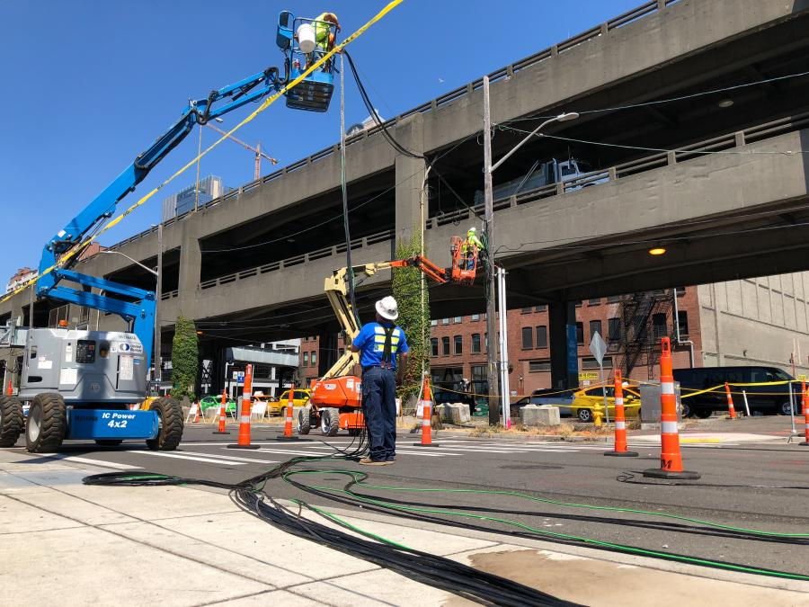 Crews work on a new traffic signal at Columbia Street.