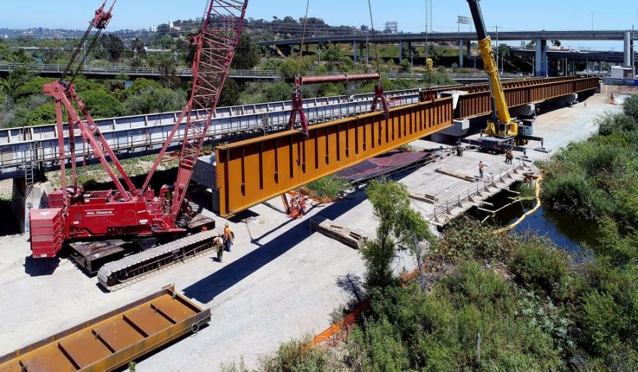 Crews place the 11-ft. deep steel girders spanning the San Diego River.