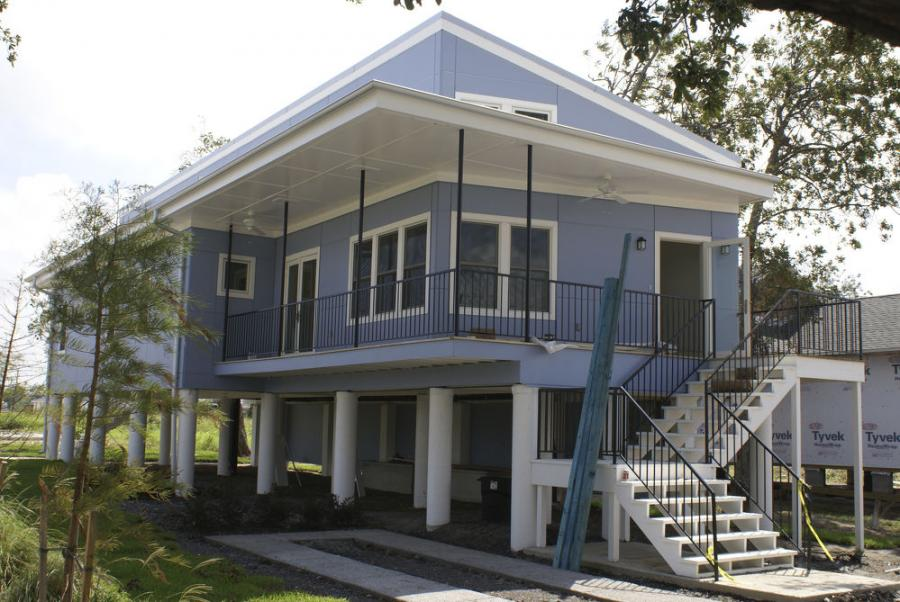 """Construction began in 2008, working toward replacing the lost housing with 150 avant-garde dwellings that were storm-safe, solar-powered, highly insulated, and """"green."""" (Photo Credit: Insurance Journal)"""