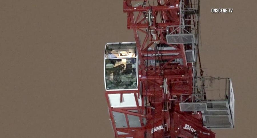 Twenty-five-year-old Edgar Vega, who was wearing only a shirt and underwear, was spotted around 11:30 p.m. inside the crane's cab, playing with the lights and controls, about 300 ft. above the ground, The Mercury News reported. (Photo Credit: The Orange County Register)