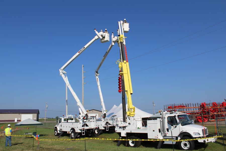At one learning station, two Terex Optima TC55 aerial devices and a C4047 digger derrick were used for changing out a transformer. Other Terex equipment used at the 40th Hands-On Training Seminar included Hi-Ranger LT40 and TL60 articulating telescopic aerial eevices, Hi-Ranger TM100 and TM125 non-overcenter aerial devices, and a 650 auger drill.