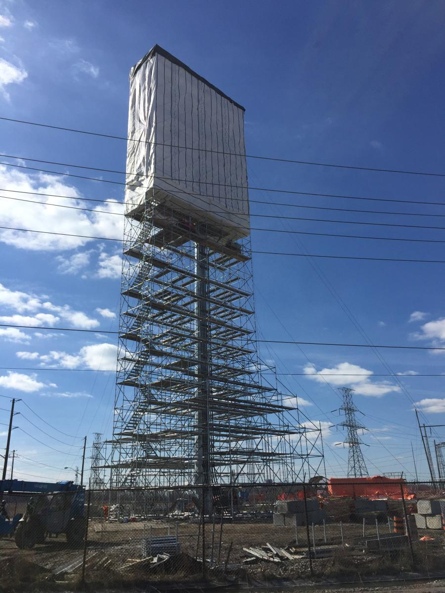 The temporary scaffolding was anchored to compact 4,000 lb. (1,814 kg) blocks tied off with cables to support up to 15 workers at one time. A tarping system allowed EHV Power to work through the harsh Ontario winter, providing a water and snow resistant environment for workers.