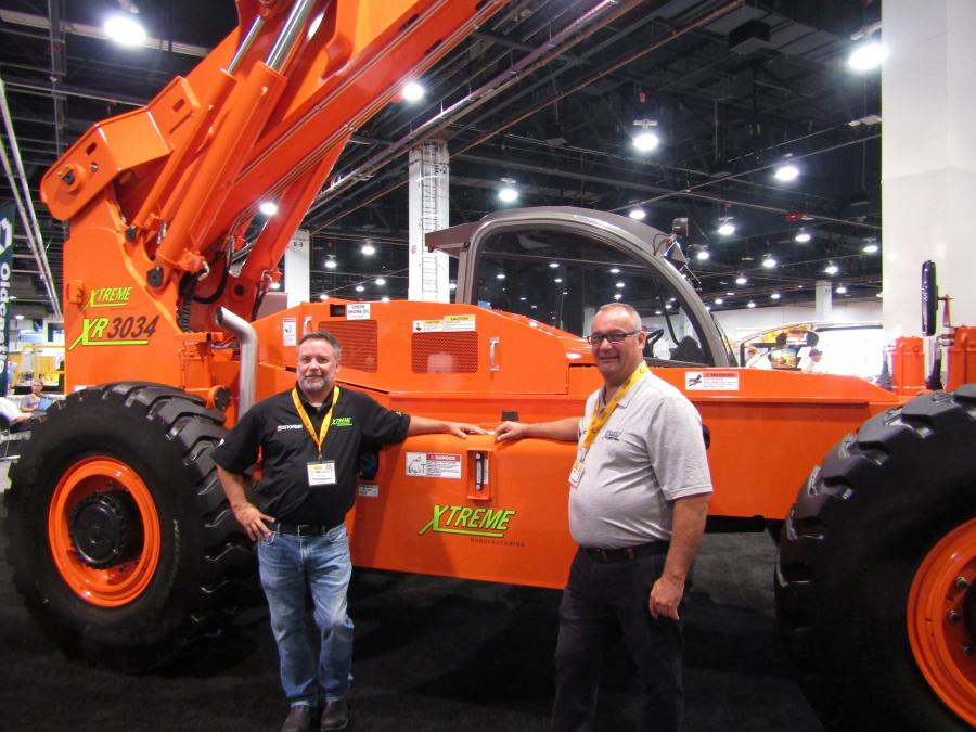 Paul Norman (L), regional sales manager, California and Nevada, of Xtrem, and Tom Bell, Xtreme sales manager of Eastern Canada, display the Xtreme XR3034 30,000-lb. capacity telehandler with up to 34-ft. lift height and 17 ft.-6 in. forward reach.