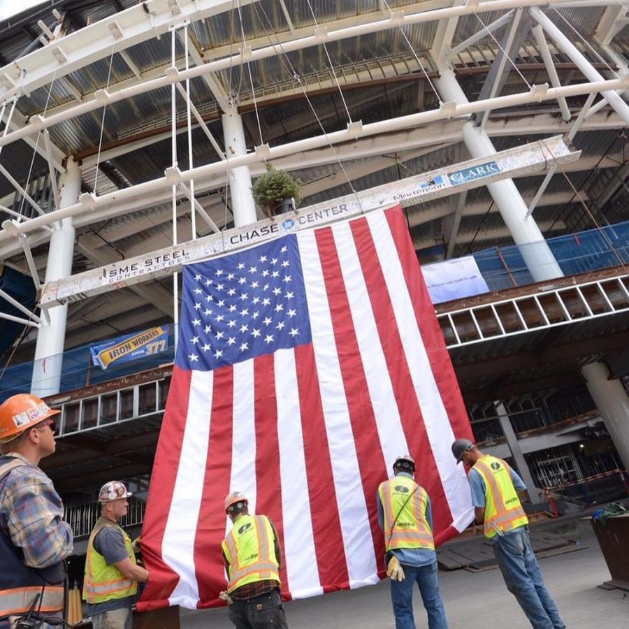 More than 9,000 tons of structural steel have been erected and more than 100,000 cu. yds. of structural cast-in-place concrete will form the entire structure.
