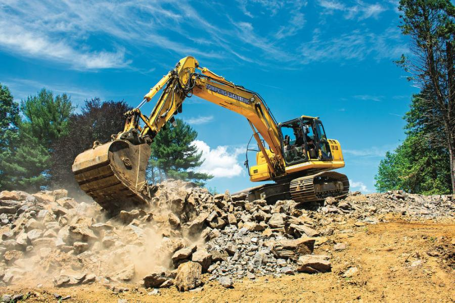 "Using integrated intelligent Machine Control technology, the Komatsu PC210LCi-11 excavator cuts to grade within a tenth of an inch after removing rock from a residential site in Chappaqua, N.Y. ""Whether you're doing drainage, sewer, water, foundations or earthmoving, you dig to grade the first time,"" explained Project Manager Kevin Tompkins."