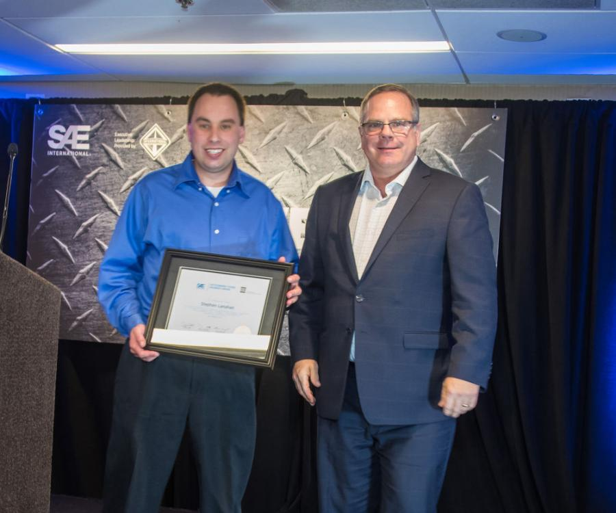 SAE/AEM Outstanding Young Engineer award winner Stephen Lanahan (L) pictured with SAE Board of Directors Commercial Vehicle Vice President Landon Sproull of PACCAR Inc. at the 2018 ceremonies.