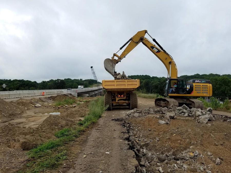 Crews in Wisconsin remove pavement near the old I-39/90 southbound-lane bridges on Rock River to stockpile for future crushing operations.
