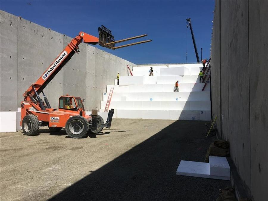 Crews place geofoam blocks in between the walls of the abutment on SR 167.
