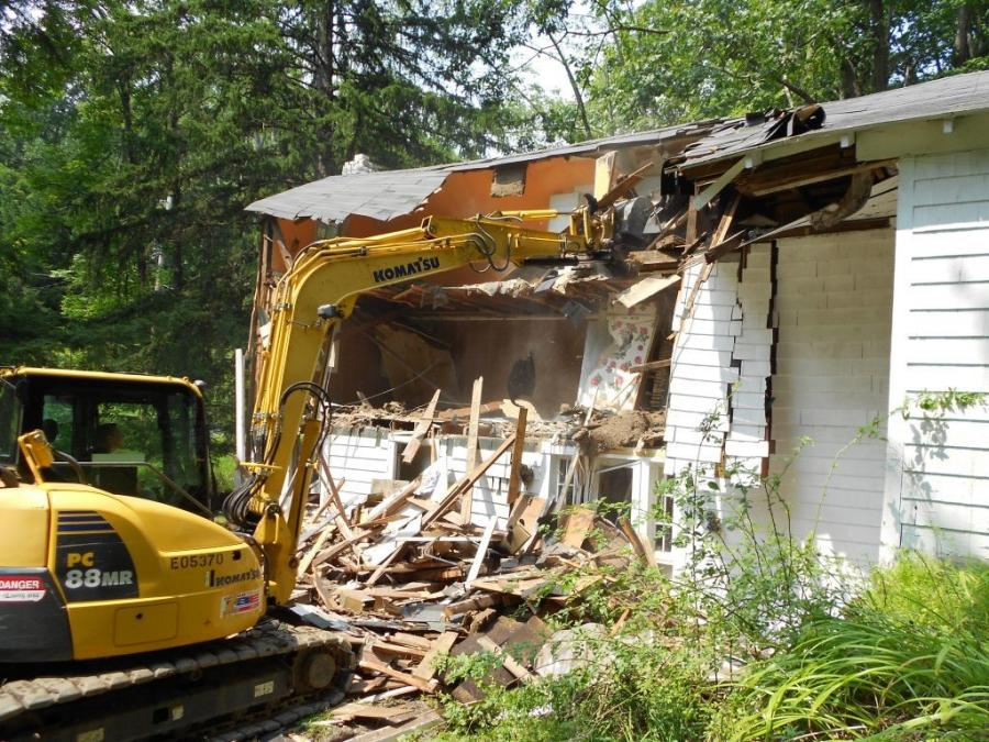 With the help of his children, wife and family friends, Costigan first demolished an existing house with a rented Komatsu excavator and a skid steer. (Photo Courtesy of Jim Costigan)