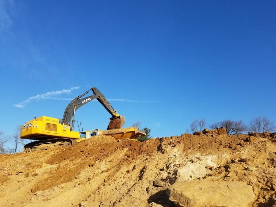 A Brubacher Excavating John Deere 450D excavator performs site work in 2017.