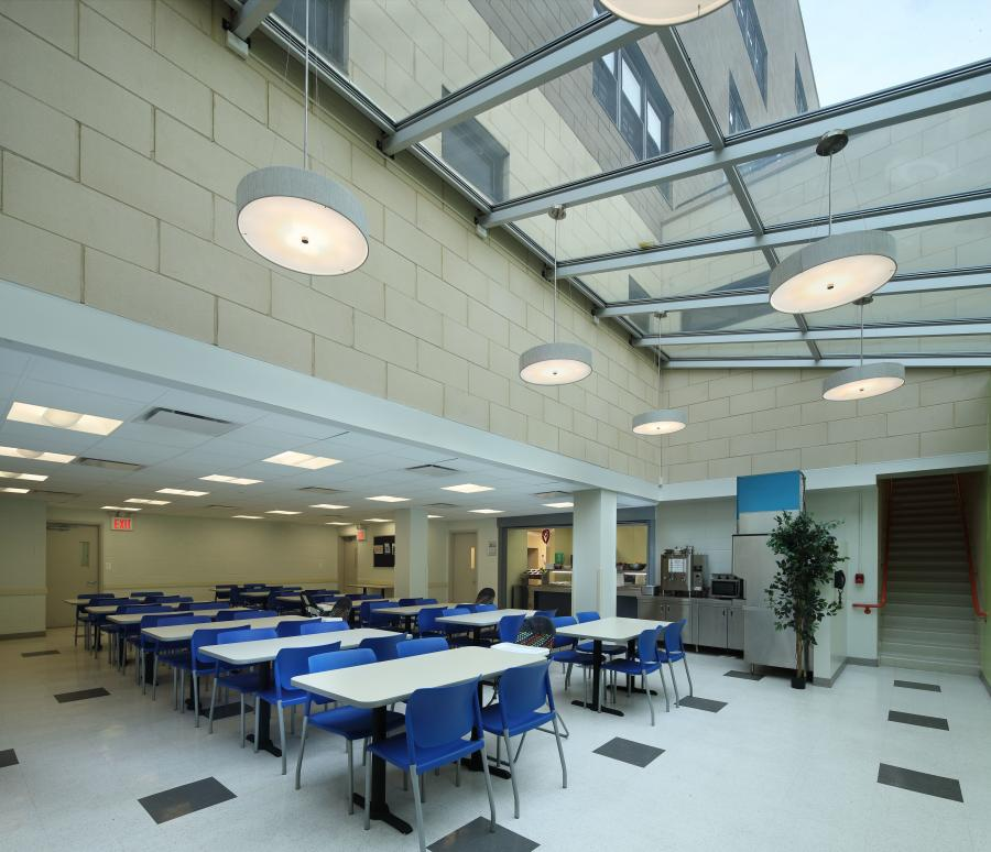 The TONA design includes a glass-roofed cafeteria that maximizes the flow of natural daylight into the space and also accommodates special events; lounges that provide a comfortable setting that can double areas for group counseling, plus brightly-colored indoor play areas serving various program needs. Common areas include the sky-lit cafeteria (with a commercial kitchen); counseling offices; a doctor's office; a library; and an art room.