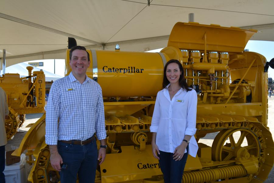 Peter J. Holt, CEO and general manager, and Corinna Holt Richter, president, both of HOLT CAT, stand in front of a 1932 Caterpillar Gas 65.