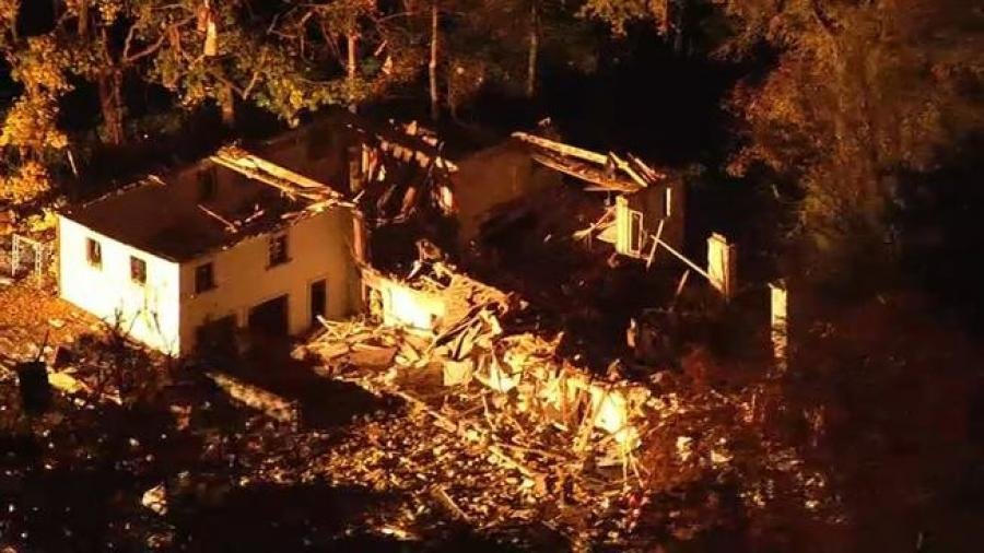 The house was undergoing extensive renovations, authorities said, and no one was inside the home at the time of the explosion. It was reduced to a few walls and rubble, as various debris ended up strewn among nearby trees. (Photo Credit: NBC News)