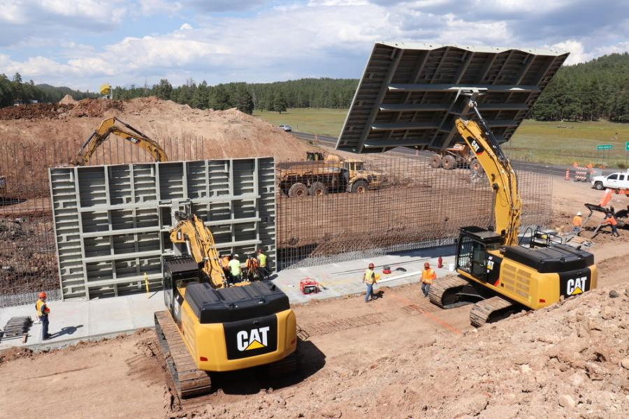 Fisher Industries proposed creating new bridge abutments by using giant steel plates attached to construction vehicles as molds around rebar cages. Once the concrete sets, the steel plates can be moved quickly, allowing crews to pour concrete for another part of the abutment.