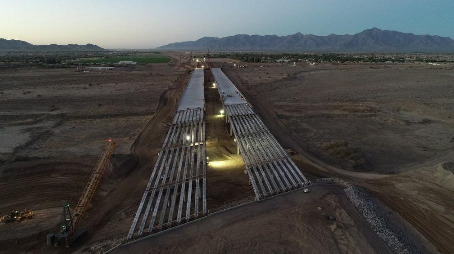 Working overnight, crews placed the final support beams for the half-mile-long northbound and southbound bridges that will carry traffic across the Salt River when the South Mountain Freeway opens as early as late 2019.
