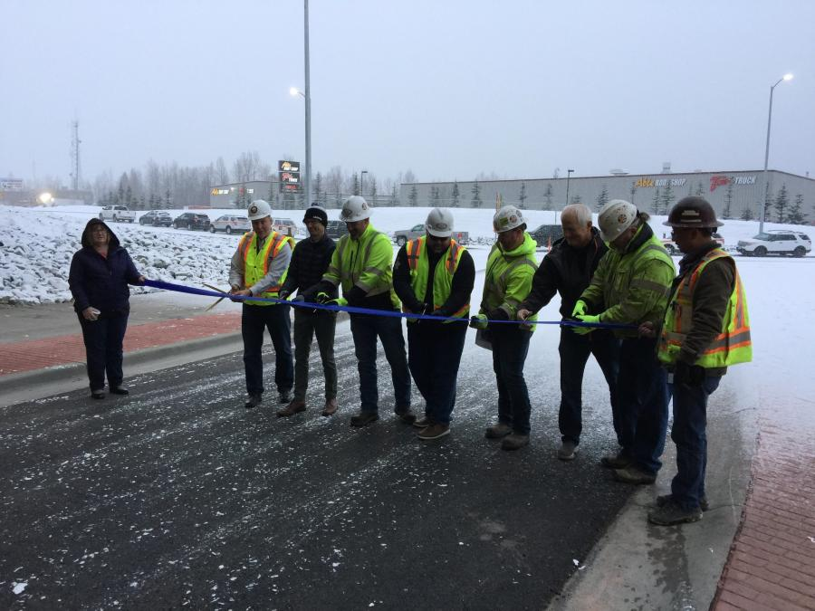 Officials cut the ribbon on the New Seward Highway underpass connecting 76th Avenue and Lore Road.