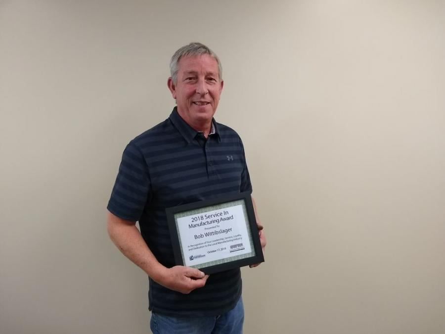 Bob Wittibslager received the Chamber of Commerce 2018 Service in Manufacturing Award for his more than 30 years of employment at Elliott Machine Works Inc. of Gallion, Ohio.