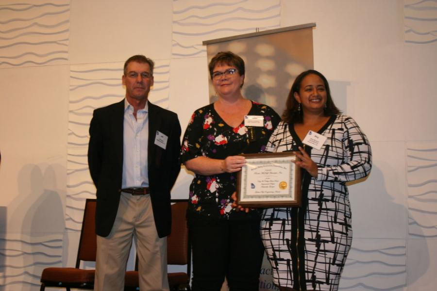 (L-R): GUCA President Jeff Rowan, Callaway Grading Inc., and GUCA Industry Relations Committee Chairperson Tammy Cawthon, Alan Cawthon Inc., recognize Meg Mbugua of Rindt-McDuff Associates (RMA) for her company's nomination for the GUCA Golden Pipe Engineering Award.