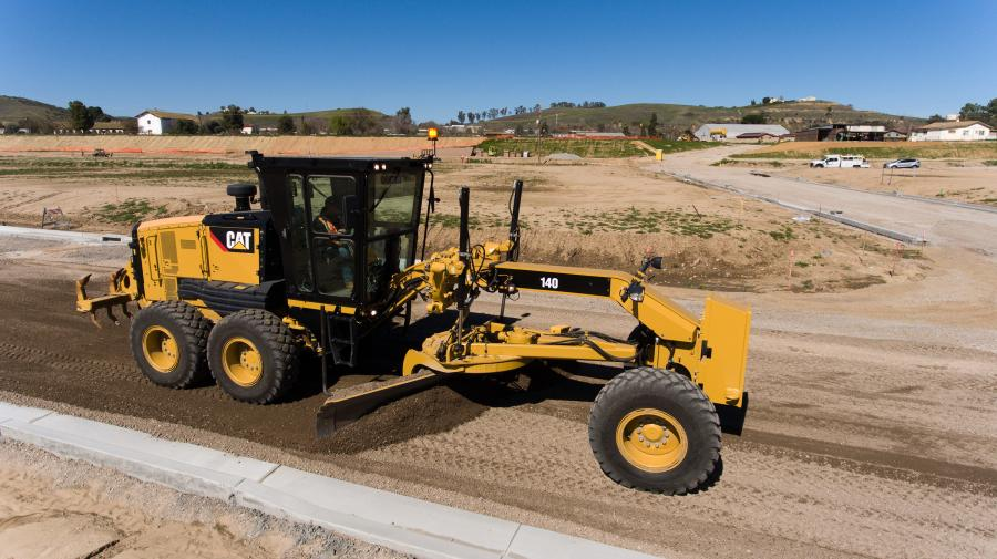 The new model offers an all-wheel-drive system option with a standard operating weight of 42,325 lbs. (19,198 kg) and features a 12-ft. mold board, a fuel-efficient Cat C9.3 engine — rated at 250 standard net hp (186 kW), an 8F/6R direct-drive power-shift transmission, and the Cat Product Link telematics system.