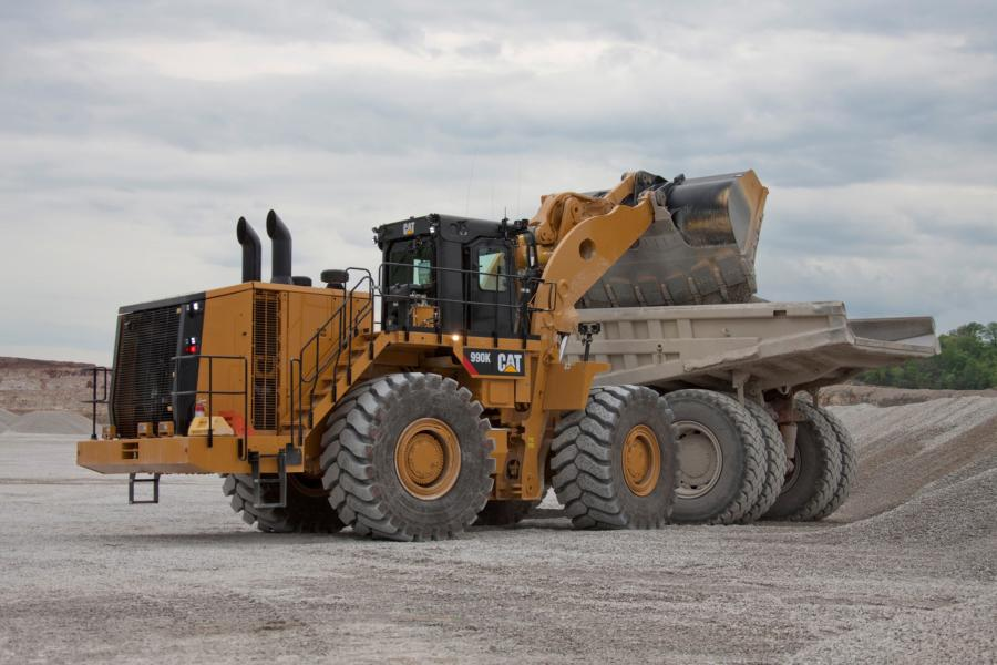 The Cat 990K Aggregate Handler has a payload of 22 tons and a full turn static tipping load of 96,426 lb.