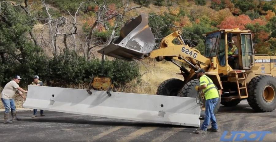 UDOT crews repurpose highway dividers to provide flood protection.
