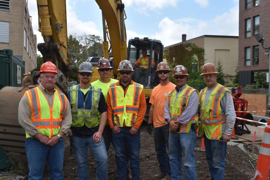 (L-R) are Craig Cypret, general manager of T-Quip; Kevin Swartz, T-Quip sales and rental rep of greater Boston; Corey Goldie, labor foreman, BOND; Shawn Hubbard, fleet manager, BOND; Rico Bisbano, equipment operator (in machine); Andrew Goldie, laborer, BOND; Johnny Williams, superintendent, BOND; and Paul Rutledge, laborer, BOND.