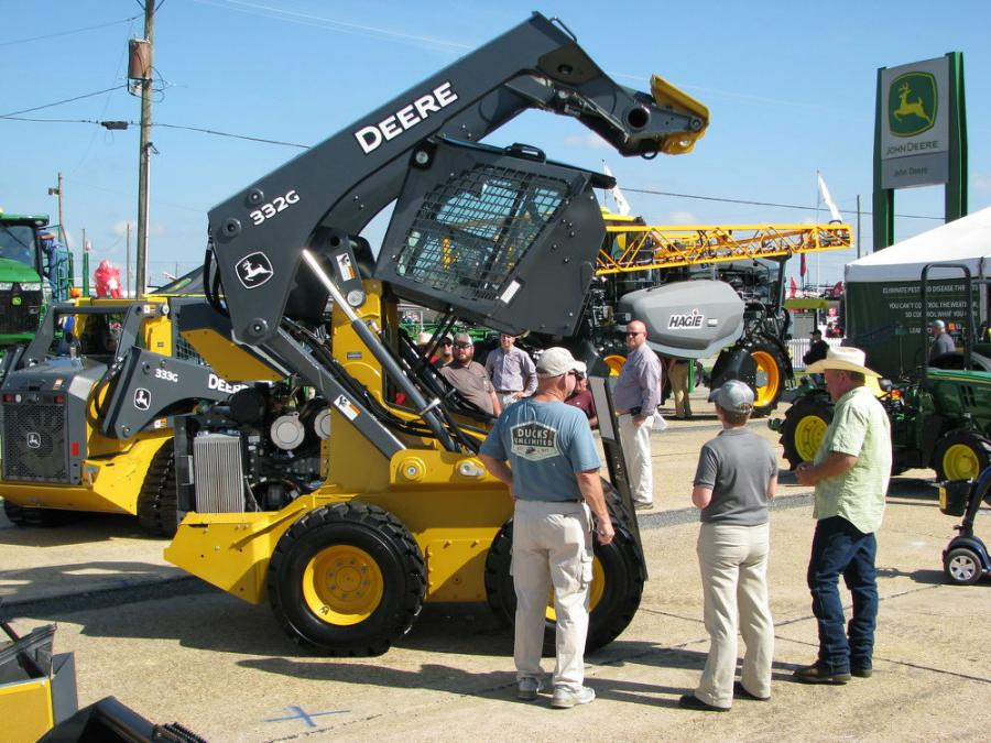 A Deere skid steer loader and compact track loader stood out in the sea of green in the John Deere exhibit.
