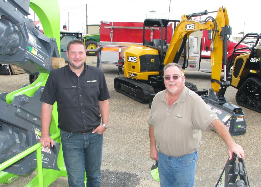 Blake Eavenson (L) and Bill Schafer of Loftness Mfg., Hector, Minn., had a nice selection of ag and construction attachments in their display area.