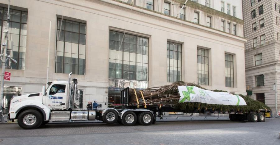 This year's 78-foot Pine tree was transported with a Kenworth T880 from Foxboro, Mass., where the tree was cut, to the entrance of the New York Stock Exchange.