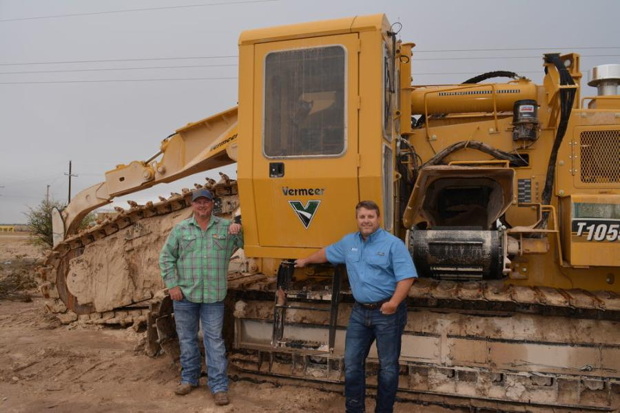 Stephen Elliott (L), Hugo Construction superintendent, and Chris May, Vermeer Texas-Louisiana representative, along with the Vermeer T1055 trencher.