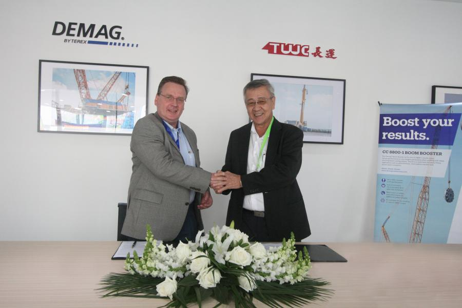 Norbert Dudek (L), vice president and general manager, Terex Cranes Asia, and Ang Kah Hong, chairman and chief executive officer, TWC.