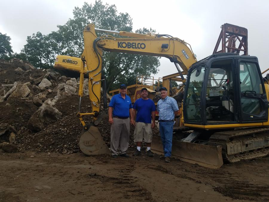 Ron Cianuciulli (C), owner of Atlas Asphalt, recently purchased a Kobelco SK75 from All Island Equipment. Pictured with him are Terry Ober (L) of Kobelco and Gary Wade of All Island Equipment.