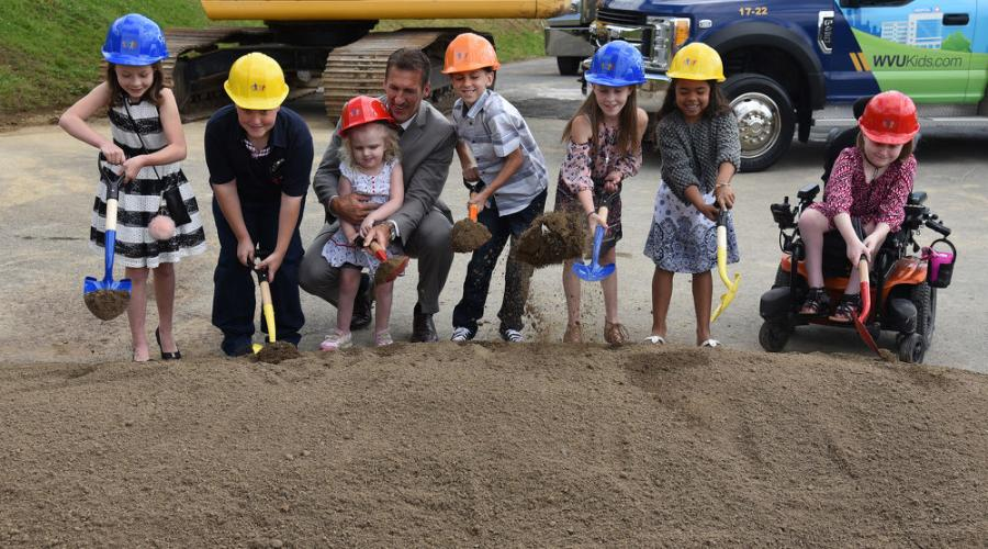(L-R): Larkin Coker, 8, of Morgantown; Brody Wilmoth, 10, of Morgantown; Ziler Hawkins, 6, of South Charleston; Jeff Hostetler; Tyler Yost, 10, of Fairmont; Adyson Stalder, 10, of Sardis, Ohio; Ivy Martin, 6, of Morgantown; and Reilly Albertson, 11, of Fairmont break ground for the new home of WVU Medicine Children's.