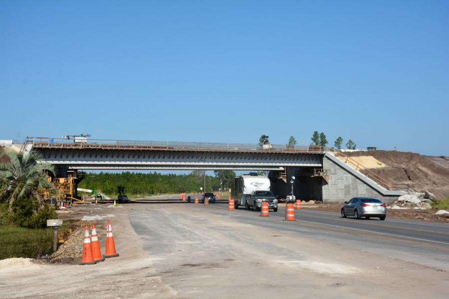 Work includes construction of bridges over County Road 100A and County Road 229.