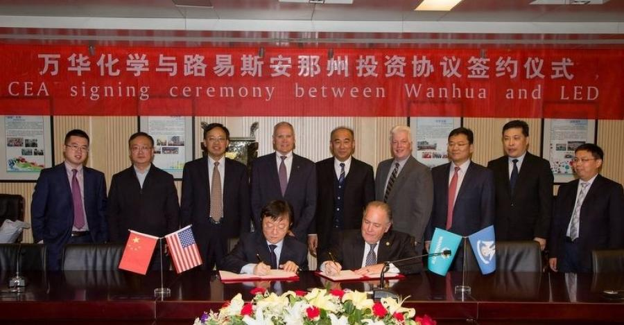 John Bel Edwards and Wanhua Chemical Group Co. Ltd. executive Weiqi Hua announced the company will develop a $1.25 billion chemical manufacturing complex in Louisiana.