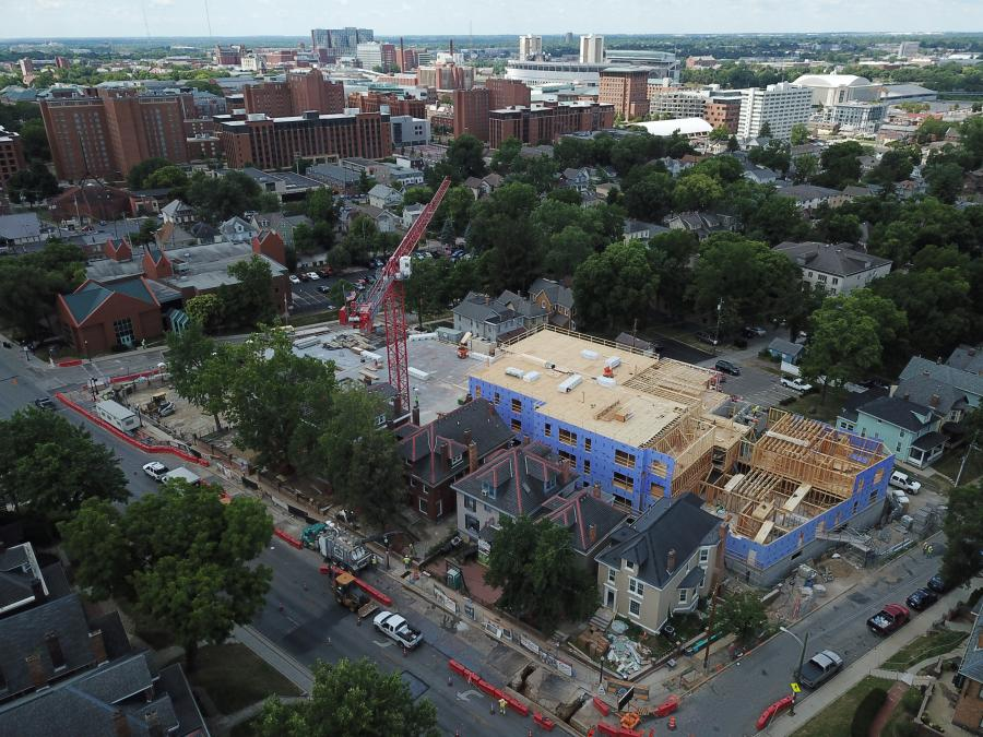 With the skyline of Columbus in the background, a tower crane looms over the construction site of The View on Pavey Square.