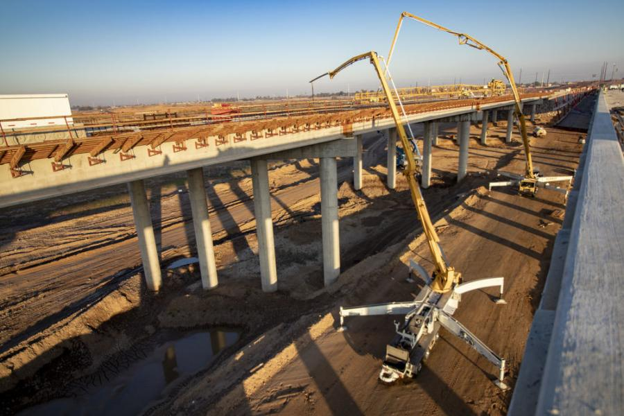 After pouring the concrete, mostly during overnight hours, crews used a self-propelled concrete leveling machine called a Bid-Well to create smooth, uniform decks for the bridges. (Arizona Department of Transportation photo)