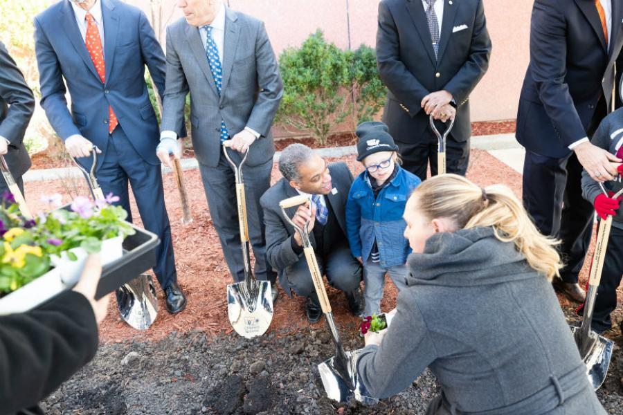 As part of the ceremony, current and former patients representing Children's National Rare Disease Institute planted shrubs in a planter on the site.