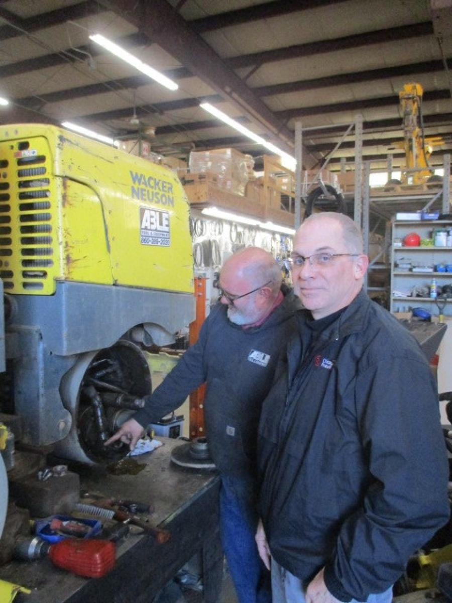Tim Stewart (R) reviews a Wacker Roller repair with Lead Tech Pete Davis.