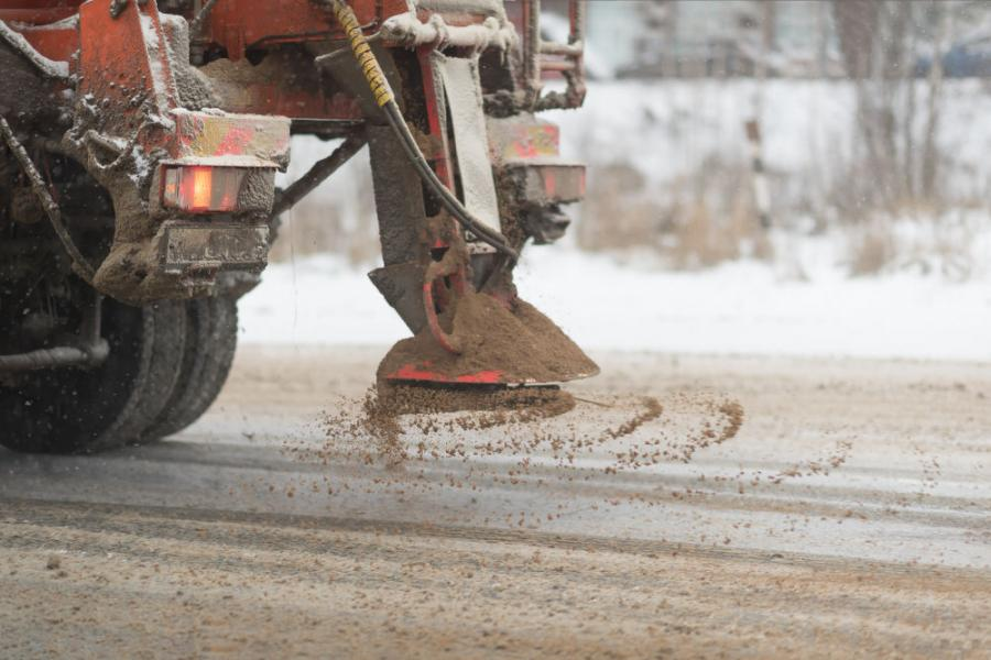 The damaging effect of treating concrete roads with calcium chloride salt is caused by one of its byproducts: calcium oxychloride, which expands inside concrete surfaces and causes cracking.