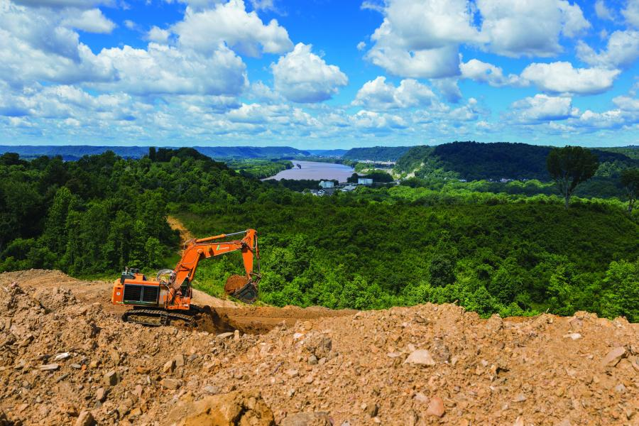Using six Hitachi EX1200 excavators, Beaver Excavating Co. moved 1 million cu. yds. of material a month in a massive road project near the Ohio River.