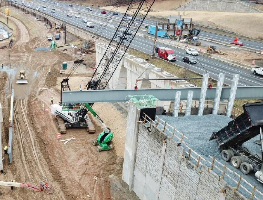 Crews prepare to install new steel on the future Watkins Mill Road Bridge over I-270. (MDOT SHA photo)