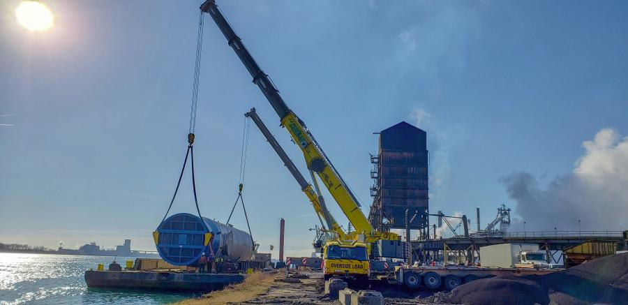 "The project involved hoisting a 116.5 ton (105.6 t) gas ""scrubber,"" which was 109 ft. (33 m) long and 19.5 ft. (5.9 m) in diameter, from a barge docked on the Detroit River to the dock on Zug Island."