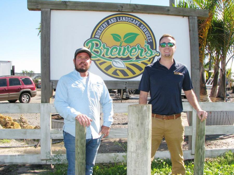 Lee Brewer (L) and Billy Burr of MacKinnon JCB at Brewer's Landscape Services in Bradenton, Fla.
