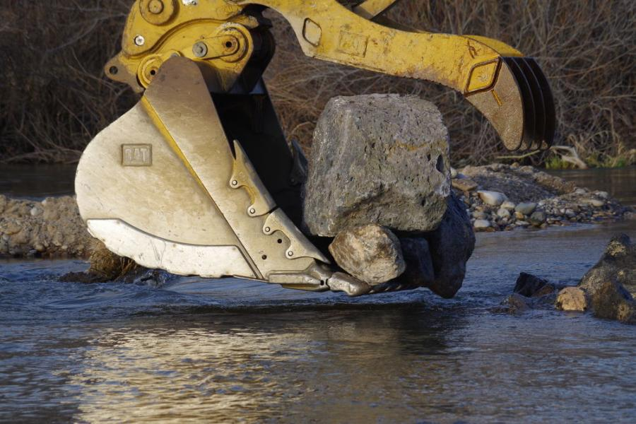 A late start on flood management projects on the Boise River in Idaho had contractors hustling to make the most of their time before the short window of the construction season ends.