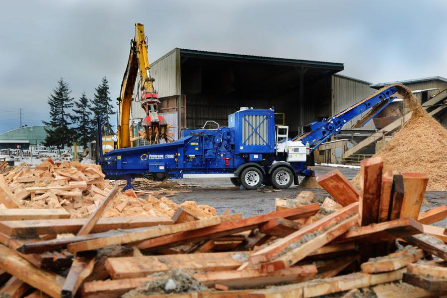 The Peterson 1700D horizontal grinder processing wood scrap.